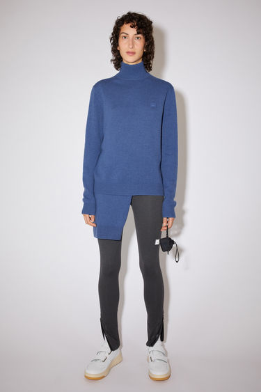 Acne Studios dusty blue turtleneck sweater is made from wool with a face logo patch and ribbed details.