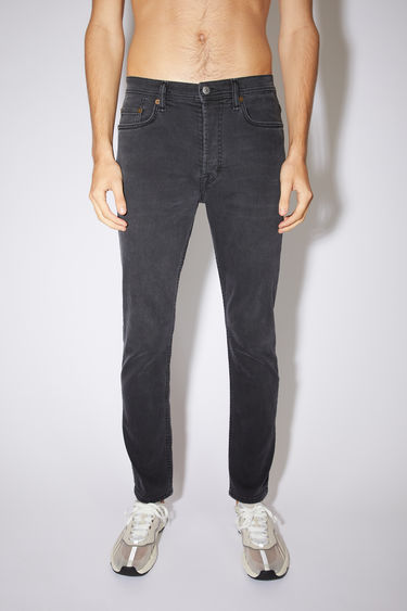 Acne Studios used black jeans are made from comfort stretch denim with a high rise and a slim, tapered leg.