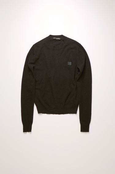 Acne Studios black crew neck sweater is made from wool with a face logo patch and ribbed details.