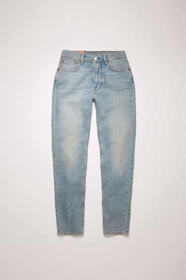 Acne Studios Melk Lt blue jeans are crafted from comfort stretch denim that's washed to give a worn-in appeal. They're cut to a high-rise waist with a slim, tapered leg and accented with subtle whiskering and fading.