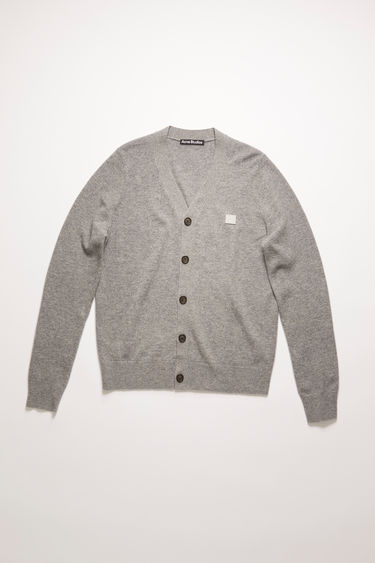 Acne Studios grey melange cardigan is knitted with a fine gauge from soft wool yarns and accented with a tonal face-embroidered patch on the chest.