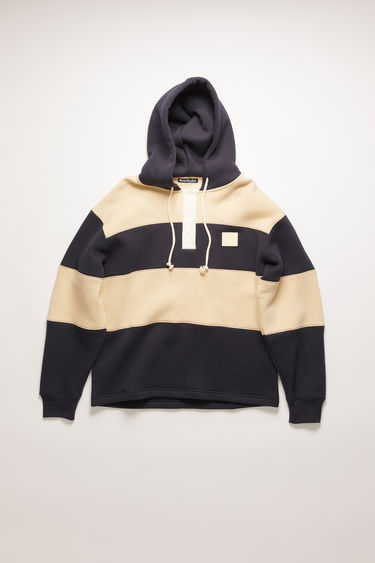 Acne Studios navy hooded rugby sweatshirt is cut from heavyweight brushed jersey that's patterned with block stripes and has a contrasting button placket and a face-embroidered patch on the chest.