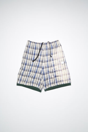 Acne Studios oat beige/blue basketball-inspired organic cotton flannel shorts features a bleached treatment and embroidered face patch.
