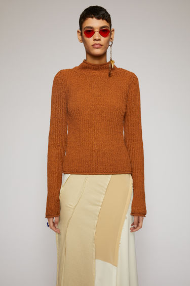 Acne Studios cognac brown sweater is knitted in a full cardigan stitch with a mock neck and finished with rolled edges on the neck, cuffs and hem.