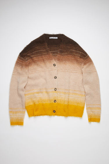 Acne Studios brown/multi fluffy, striped cardigan sweater is made of a soft alpaca blend with a relaxed fit.