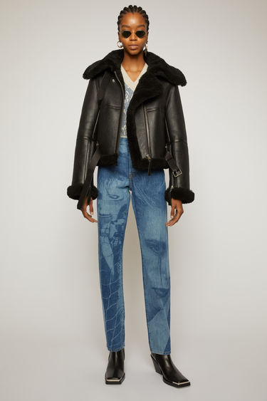 Acne Studios black/black shearling jacket is crafted with soft lamb shearling edges and framed with tonal leather trims.