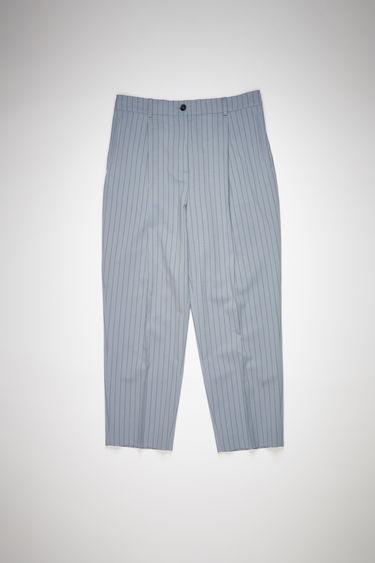 Acne Studios light blue/navy pleated trousers are made of pinstriped wool with a classic fit.