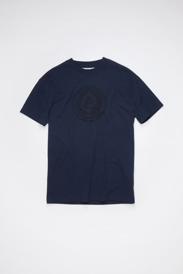 Acne Studios navy crew neck t-shirt is made of cotton and features an embroidered design.