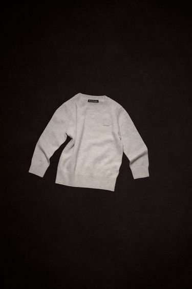Acne Studios children's light grey melange sweater is finely knitted from wool and neatly finished ribbed trims and a tonal face patch.