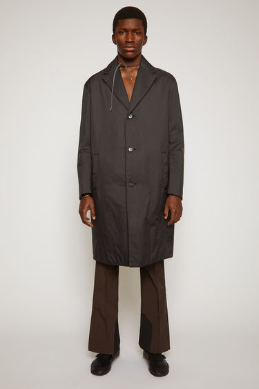 Acne Studios black padded coat is crafted from matte ripstop to a single-breated silhouette with quilted lining and has wide notched lapels and two side welt pockets.