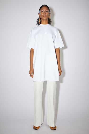 Acne Studios optic white casual t-shirt dress is made of cotton with an Acne Studios logo at the centre front.
