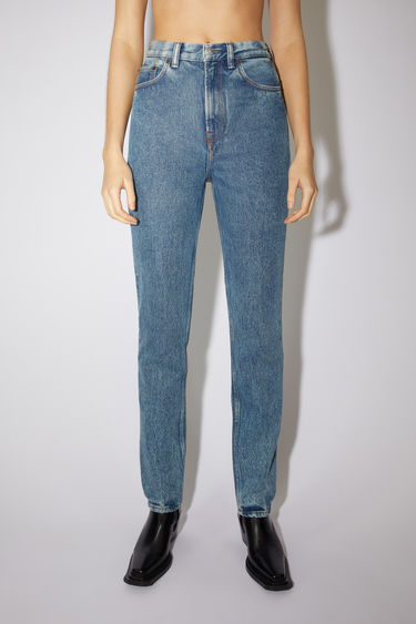 Acne Studios 1995 Blue Pepper Rigid jeans are crafted from rigid denim that's stonewashed to give a worn-in appeal. They're shaped to sit high on the waist before falling to a slim, straight leg.