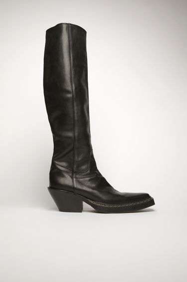 Acne Studios black western boots are crafted from rustic grained leather and feature an elongated point toe and a fitted shaft. It's set on a slanted block heel and finished a metal zip fastening on the side.