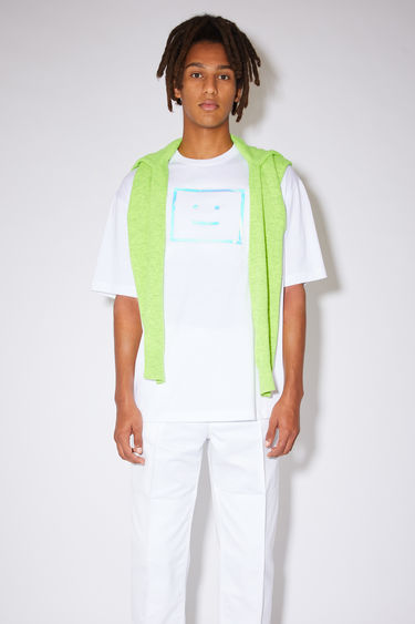 Acne Studios optic white relaxed fit t-shirt is made of organic cotton with a ribbed crew neck and metallic face print.