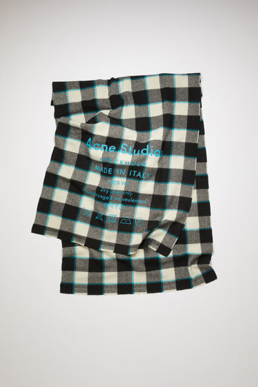 Acne Studios black/white scarf is patterned with a check design and features a screen printed Acne Studios logo and care label.