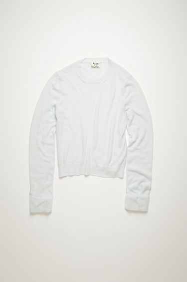 Acne Studios ice blue sweater is crafted to a slim sihouette and features a brushed texture with a sheen finish. It's shaped with a crew neck and finished with ribbed edges.