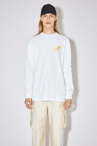 Acne Studios optic white long sleeve t-shirt is made of cotton with a print at the chest and down one arm, in collaboration with Knekelhuis and Dizonord, a record store in Paris, France.