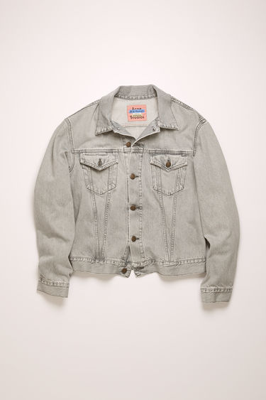 Acne Studios 1998 Stone Grey jacket is crafted from rigid denim that's stonewashed to give a worn-in appeal. It's cut to a slim silhouette with chest patch pockets and accented with branded metal buttons.