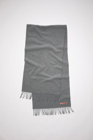 Acne Studios grey melange narrow fringed scarf is made of pure wool, featuring a label in one corner.
