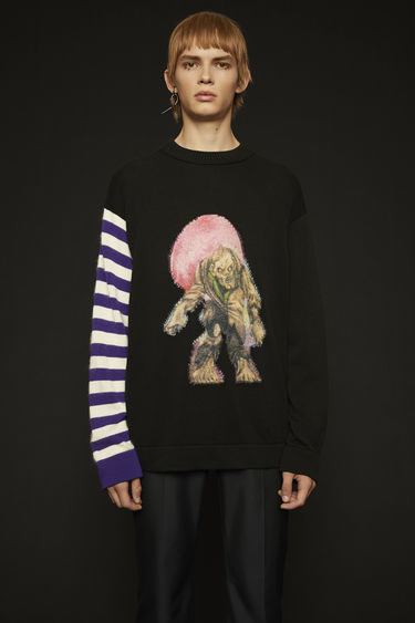 Acne Studios launches an exclusive range with Monster in My PocketⓇ. This purple/multi sweater is crafted from fine-gauge cotton and features a striped sleeve and a zombie motif with a pilled finish.