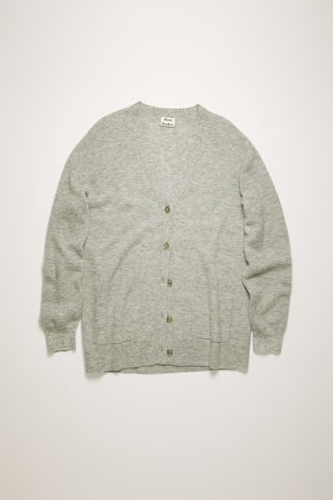 Acne Studios grey melange cardigan is crafted in a full cardigan stitch from an alpaca and wool blend and shaped to a relaxed fit with exposed seams running along the shoulders.