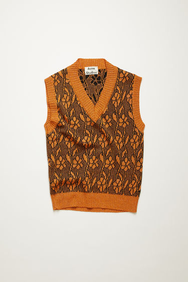 Acne Studios orange vest is knitted from metallic lurex yarns and patterned with jacquard flowers. It's shaped with a v-neck and framed with ribbed edges.