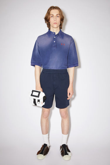 Acne Studios navy loose-fitting shorts are made of a cotton twill with a slight stretch.