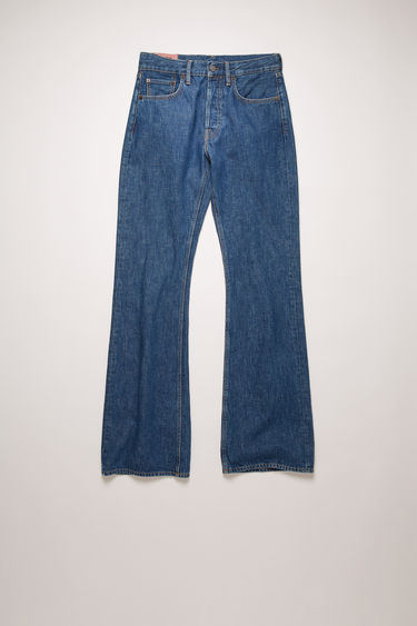 Acne Studios 1992M Dark Blue Trash jeans are cut from rigid denim that's stonewashed for a time-worn appeal. They're cut to a relaxed, bootcut silhouette with a high-rise waist and finished with a concealed button placket.