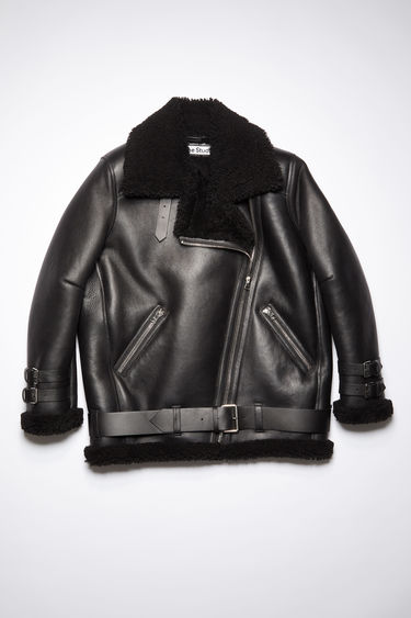 Acne Studios Velocite black shearling jacket is crafted from soft lamb shearling and accented with leather buckle straps at the neck, cuffs and hem.