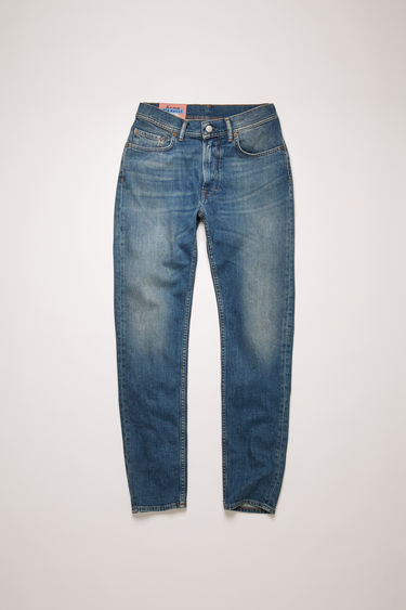 Acne Studios Melk Mid blue jeans are crafted from comfort stretch denim that's washed to give a worn-in appeal. They're cut to a high-rise waist with a slim, tapered leg and accented with subtle whiskering and fading.