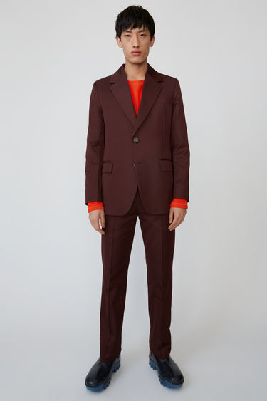 Acne Studios chestnut brown is a classic, tailored jacket with wide notch lapels.