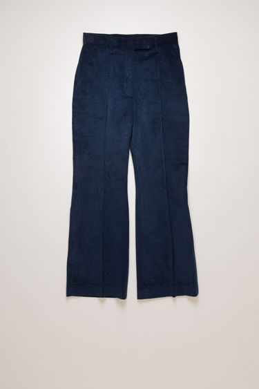 Acne Studios ink blue corduroy trousers are cut slim through the hips and feature cropped, kick-flare legs with pressed creases for a refined finish.