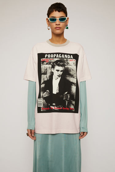 Acne Studios cold beige t-shirt is crafted from lightweight slubbed cotton and features prints from the Propaganda Magazine on front and back.