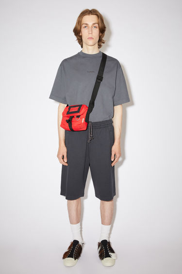 Acne Studios black relaxed fit shorts are made of cotton with an elasticised waistband.