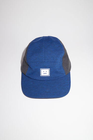 Acne Studios teal blue baseball cap is made from two tone jersey with a face logo patch.