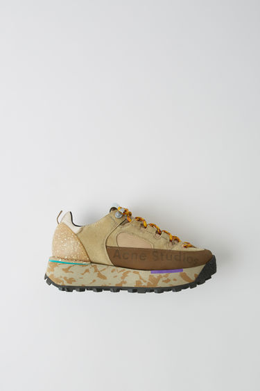 Acne Studios multi beige boots are reinterpreted from the trekking footwear from the 90's. They are constructed with a layered upper and set on a multicoloured lug-sole.