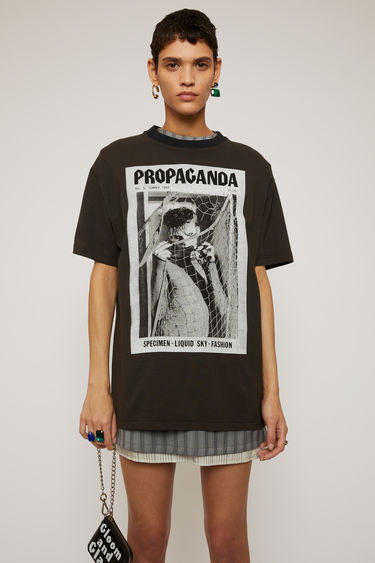 Acne Studios faded black t-shirt is crafted from lightweight slubbed cotton and features prints from the Propaganda Magazine on front and back.