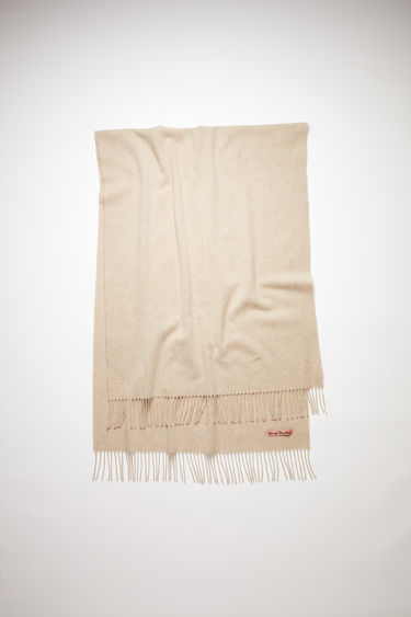 Acne Studios oatmeal melange oversized fringed scarf is made of pure wool, featuring a label in one corner.