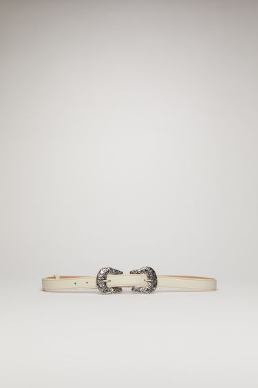 Acne Studios white belt is crafted from soft cow leather with thick topstitching and features antiqued silver-tone buckles engraved with flowers and baroque swirls.