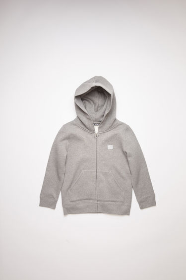 Acne Studios Mini Ferris Zip F light grey melange is a hooded sweatshirt crafted from midweight brushed jersey with a zip-up front closure and kangaroo pockets and accented with a tonal face-embroidered patch on the chest.