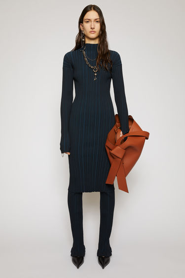 Acne Studios midnight blue dress is knitted from mercerized cotton with an irregular ribbed pattern and is shaped to a slim-fitting profile with a mock neckline.