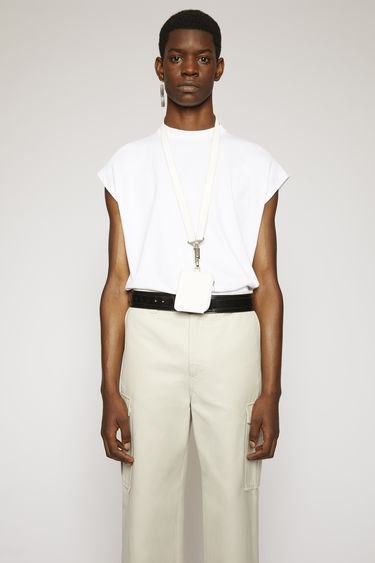 Acne Studios optic white t-shirt is cut to a boxy shape from lightweight jersey and shaped with a round neck and cap sleeves.