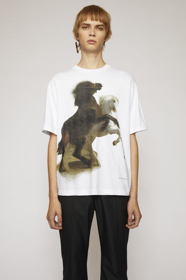 Acne Studios optic white t-shirt is crafted to a boxy silhouette from textured cotton jersey and features a print of galloping horses.