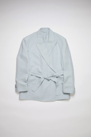 Acne Studios ice blue constructed suit jacket is made of a linen/cotton blend and has a relaxed fit.