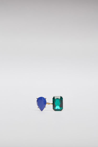Acne Studios dark blue/green ring is crafted with a slim open band and embellished with two different gemstones on each end.