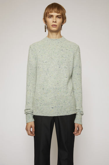 Acne Studios pastel green melange sweater is designed to look like an old favourite. It's made from a soft wool and cashmere blend with a pilled texture and finished with ribbed trims.