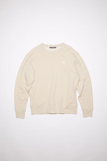 Acne Studios oatmeal beige crew neck sweatshirt is made of organic cotton with a face patch and ribbed details.