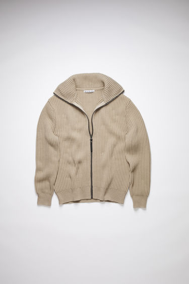 Acne Studios hazel beige rib knit collared sweater is made of a cotton blend with a centre front zipper closure.