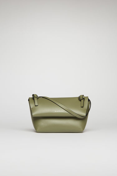 Acne Studios dark green/black mini purse is crafted from soft cow leather and detailed with an obi-inspired knot on each end of the crossbody strap.