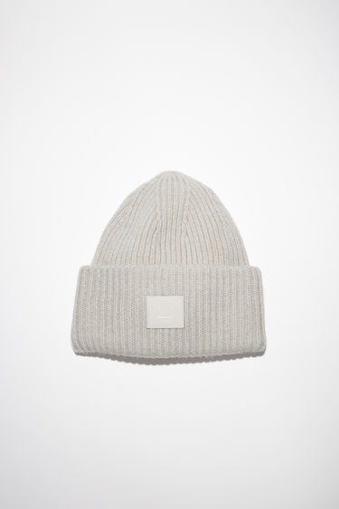 Acne Studios light grey melange beanie hat is made from rib knit wool with a face logo patch.